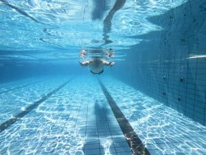 Underwater view of man in swimming pool improve circulation exercise